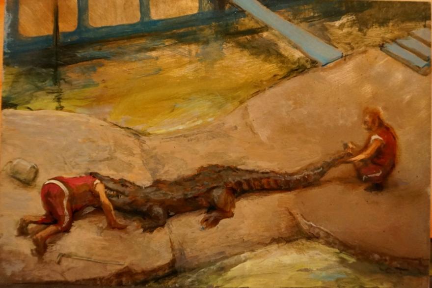 man-with-his-head-stuck-in-a-crocodile-on-tin